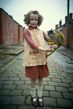"""June Mothershead (Honor Kneafsley) with Mortimer, a squirrel monkey.  """"Our Zoo"""", ep 1, BBC drama set in thirties."""