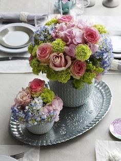Lovely flowers arranged in vintage silver. Ana Rosa