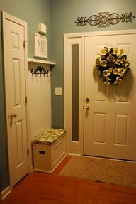 Entryway: narrow bench to dump shoes in. Wainscoting above with hooks and shelf.