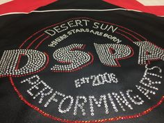 Custom Rhinestone warm up jacket for Desert Sun Performing Arts. Looking to get custom rhinestone apparel for your team? Call 248-499-9303 or email info@monogramthat.com. No set up fees! No minimum orders! We can even set up a team store for you. At teammonogramthat.com