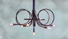 Black Magic Chandelier by Lightsculptures by timothy j ferrie.  So great.  Completely customizable.