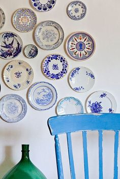 A range of different blue and white plates on a wall as a feature .. different