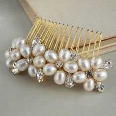 Dew Pearl Wedding Hair Comb - £50 - made from: Freshwater pearls, crystal diamantes and gold plated metal.  dimensions: The decoration measures 10cm x 3.5cm set on a 6cm x 3.5cm comb base.