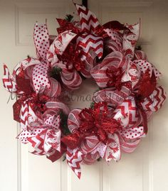 This is a red and white stripe deco mesh Christmas Wreath. It has 4 different types of ribbon, snowman, chevron, polka dot and solid red