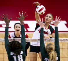 Nebraska senior Gina Mancuso scores a kill over two Michigan State blockers on Wednesday, Sept. 26, 2012, at the NU Coliseum.
