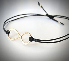 Vermeil Infinity bracelet on black linen. $24 from JewelryByMaeBee on Etsy. >> Beautiful!