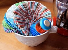 What is it that's so addictive about kitchen linens? I have a collection that brightens up my baking rack. Most were handmade by friends and family, so just having them displayed makes me happy and I wash, iron and fold them carefully after each use so they'll stay nice. The round knit dishcloth stack is …