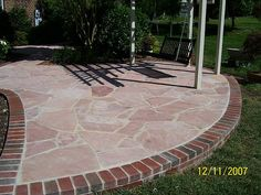 Highland Rose Stone Patio With 8 Inch Brick Border.