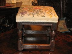 """MID 17TH CENTURY ENGLISH OAK UPHOLSTERED STOOL. CIRCA 1650.    EXCELLENT COLOUR AND PATINATION. WITH LATER NEEDLEPOINT UPHOLSTERED SEAT.  13"""" WIDE X 13"""" DEEP X 13"""" HIGH."""