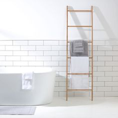 decorative Bamboo Ladder from Kmart.  I'd like to have this hanging from ceiling with a pulley system and dry herbs from it