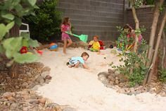 Sand play area for kids, rock edging to help with sand spillover