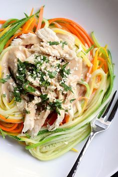 Zucchini noodles with Chicken and Peanut Sauce. I want that vegetable peeler, too.
