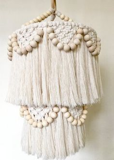 This made-to-order macrame beaded fringed mobile is perfect to hang as a light shade or simply a decorative mobile to make your home feel beautiful.