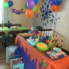 Splatoon birthday party. Drew paint splats on color card board then cut it and tape to walls for decorations. Printed some Splatoon character pics, cut them and also taped to wall. I cut up plastic table cloth to resemble paint for the table covers.