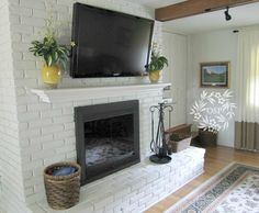 Painted Brick Fireplace Makeover TV over mantle on brick fireplace