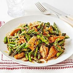 Orange Chicken with Asparagus, easy and healthy. Heat 1 tablespoon sesame oil in a large skillet over medium heat. Saute 4 ounces chicken, sliced into 1/2-inch strips, 1 minced garlic clove, and 1/4 teaspoon red pepper flakes 7 minutes. Add 2 cups chopped asparagus and cook 3 minutes more. In a small bowl, whisk together 1 teaspoon reduced-sodium soy sauce, 1 teaspoon honey, 1 teaspoon sesame seeds, and juice and zest of 1 orange. Add to skillet and cook 1 minute. Serve over brown rice.