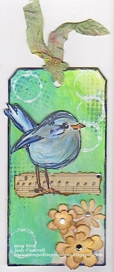 Song bird stamp by Dina Wakley, flowers made with strip die by Tim Holtz. Background made with Dina Wakley mixed media paints.