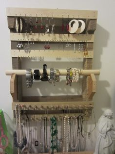 I made this organizer for my wife. I got the idea from an organizer that someone bought and pinned. It took about 2.5 hours to make and cost me around $7. Its made form an old pallet I got for free and small pieces of wood that I bought at home depot. The watch holder is from an old curtain rod my landlord left after they moved out.