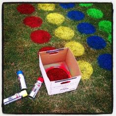 DIY - SUMMER FAMILY FUN Supplies Needed: 1 - Cardboard Box 1 - Can of Red Spray Paint 1 - Can of Yellow Spray Paint 1 - Can of Blue Spray Paint 1 - Can of Green Spray Paint  Directions: Cut circle in bottom of the cardboard box Spray circles evenly spaced as seen in the picture Let paint dry Then let the fun begin! :-)