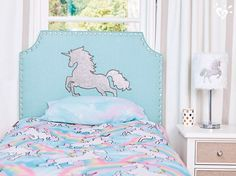 Add magical style to her room with this sparkling unicorn headboard, matching bedding, so-special lamp and more.