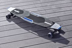 AUDI's electric longboard/Scooter stows away in the bumper of the Q3 Connected Mobility concept