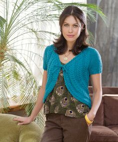 Create cables that curve from neckline around back and up to other side. This gentle design is versatile enough to go from casual to evening and always look great.
