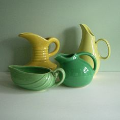 Vintage pottery-we have the round green creamer (the Sevilla line which I *thought* was Cronin potteries but now unsure) as well as its sugar bowl and the same pitcher in turquoise and cobalt blue! I think the tall yellow pitcher is Franciscan...