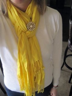 Scarf tying trick- Fold scarf in half. Loop around neck. Pull only one strand of the scarf through the loop. Twist loop, then pull other strand through, finish with a cute pin or fabric flower! - Click image to find more My Life Pinterest pins