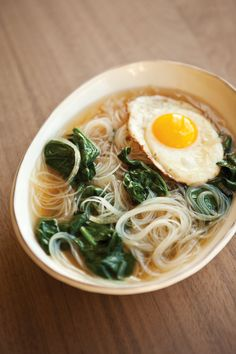 Spinach noodle soup with fried egg