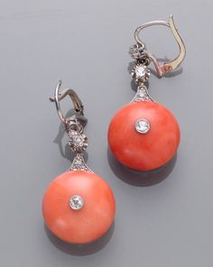 A pair of art deco diamond, coral and platinum earrings