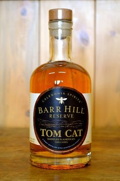 Barr Hill Tom Cat Reserve:  Tomcat Collins Barr Hill Reserve Tomcat Gin, Lemon Juice, Honey Syrup, Champagne Our house Tom Collins is prepared with Tomcat barrel-aged gin sweetened with honey, and a splash of sparkling wine instead of soda.