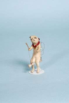 Antique christmas ornament, spun cotton cat playing with toy