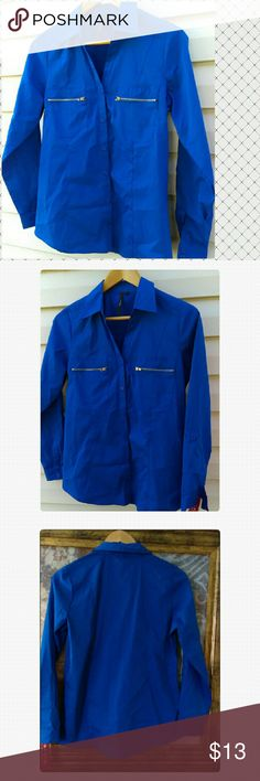 Cathy Daniel  Long sleeve Blue shirt Beautiful Cathy Daniels long sleeve blue zipper pocket  Button shirt can be worn for work or pair with jeans for casual look carry some stretch Bust size 36  Size M.   New with tags Cathy Daniel  Tops Button Down Shirts