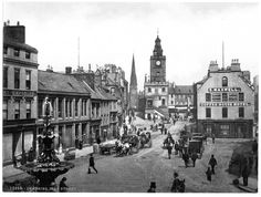 Dumfries high street is filled with gentlemen wearing Victorian fashions and horses and carts as they trundle along the cobble streets. The striking steeple in the background still stands proud today Victorian London, Victorian Era, Victorian Houses, Edwardian Era, Scottish People, England Uk, Old Pictures, Paris Skyline, Scotland