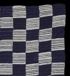 """Detail: AS517 - Rare weft-faced strip weave woven from blue and white hand spun cotton and magenta silk from the Saharan trade. Little attention has been paid to these cloths and even less is known about their precise origins, but it seems likely that some or all of them were woven by weavers living either side of the Benue River in the so-called """"Middle Belt"""" of Eastern Nigeria. Continues http://www.adireafricantextiles.com/asooke4.htm"""