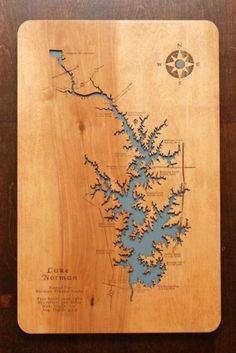 A Laser Cut Wooden Lake Map that has great detail. Looks great above our fireplace