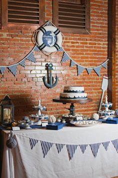 Nautical Wedding Grooms Table Party - Have sweets and candy on this table also Nautical Wedding Cakes, Nautical Bridal Showers, Simple Bridal Shower, Nautical Party, Nautical Backdrop, Nautical Wedding Centerpieces, Nautical Bunting, Navy Party, Wedding Bunting
