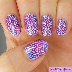 Painted Fingertips | Silver stamping over a neon pink and blue water marble