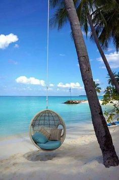 Could you imagine getting to spend your day lounging in this hanging chair enjoying the beautiful view of the crystal blue ocean water?   Sounds like a dream come true!