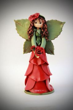 Rose Fairy by fairiesbynuria on Etsy, $39.95