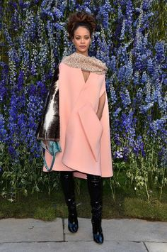The Dior spring 2016 show happened today in Paris and, no surprise, it was gorgeous. Come see all the photos we love, including this look at Rihanna's cool, peachy cape outfit