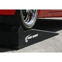 """RACE RAMPS XT  Race Ramp XT's are ideal for low ground clearance vehicles with tires up to 12"""" wide. With an incline of only 10.8 degrees, they raise the car up 10"""" and hold up to 3,000 lbs. per set while only weighing 15 lbs. each."""