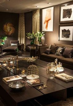 Living Room - again, I love the brown, gold, and brass colour scheme and the subdued lighting