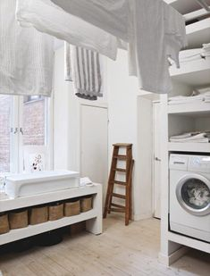 Just LOVE a good laundry room & from the raised washing machine to all of the storage, this is quite good.
