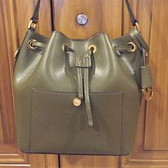 Michael Kors MD Bucket Bag Olive Michael Kors handbag MD Bucket Bag Olive excellent condition with shoulder strap which was never used and comes with a bag to keep the handbag in Michael Kors Bags Shoulder Bags