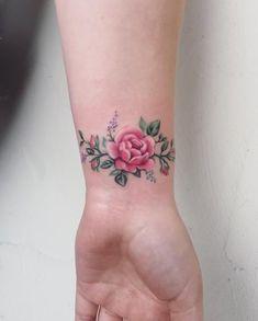 Tiny rose tattoo by Mallory Swinchock Wrist Tattoos Girls, Rose Tattoos On Wrist, Mom Tattoos, Hand Tattoos, Tatoos, Tiny Rose Tattoos, Blue Rose Tattoos, Tattoos For Women Flowers, Wrist Tattoos For Women