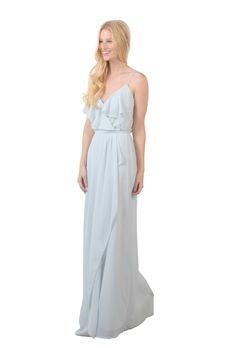 A floor-length, ruffle spaghetti strap chiffon bridesmaid dress in two colors. Affordable designer bridesmaid dresses to buy or rent at Vow To Be Chic.