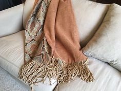 This luxurious Moroccan throw blanket is quietly amazing!!! Side one features brown, turquoise, terracota, and gold tones that are muted and soft...the fabric is an upholstery weight, probably a poly rayon blend. Side two features an orange gold mini check in chenille blend upholstery fabric that is warm and cuddly to wrap up in. Designer gold fringe on each end adds the finishing accent to this eye catching throw!!!  This super duper throw was made by me in my smoke free studio in North…
