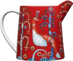 Pitcher Add the iittala Taika Red 17 oz. Pitcher to your iittala dinnerware collection. Klaus Haapaniemi's whimsical pattern now adorns a perfectly petite porcelain pitcher that is charming yet versatile.