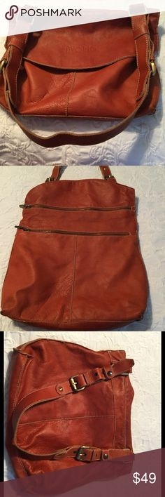 Handbag-Italian leather. Avorio genuine leather shoulder bag.  Rust leather, with extra outer zip pocket, inside zip pocket, outer hidden zip closure and adjustable strap.  Never used. Soft supple pebble leather.  NWOT. Avorio Bags Shoulder Bags